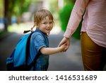 parent taking child to school....   Shutterstock . vector #1416531689