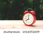 red alarm clock on the wooden... | Shutterstock . vector #1416552659