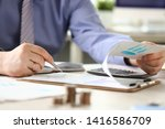 Small photo of Financial Tax Report Man Calculating Vat Expenses. Professional Bookkeeper Checking Debt Paper Graph. Audit Concept. Businessman Counting Money Using Calculator. Analyzes Economy Invoice