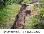 Small photo of Drainage ditch. Laying a drainage pipe. Earthwork.