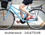 Person in profile biking in traffic - stock photo