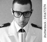 Portrait of a funny handsome hipster groom (dude) in trendy glasses drinking something from tin can through plastic sipper. Daylight. Close up. Black and white (monochrome) studio shot - stock photo
