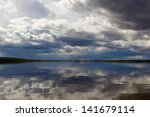 Water Landscape With Clouds An...
