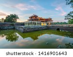 """Small photo of Wonderful view of the """" Meridian Gate Hue """" to the Imperial City with the Purple Forbidden City within the Citadel in Hue, Vietnam. Imperial Royal Palace of Nguyen dynasty in Hue. Hue is a popular"""