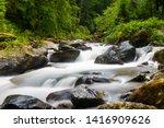 Long Exposure On River Flowing...