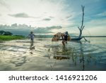 A Boy Fisherman With Catching...