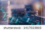 Small photo of Financial investment concept, Double exposure of city night and stack of coins for finance investor, Forex trading candlestick chart, Cryptocurrency Digital economy. background for invest