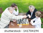 Four Generations Of Men Playin...