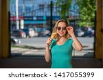 a happy woman in a turquoise... | Shutterstock . vector #1417055399