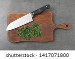 wooden board with sharp knife...   Shutterstock . vector #1417071800