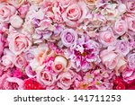 Stock photo floral background lot of artificial flowers in colorful composition 141711253