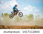 Motocross Rider Jump in a blue sky with clouds.Enduro bike rider in action.  - stock photo