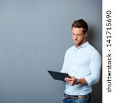 serious young male executive... | Shutterstock . vector #141715690