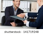 happy businessman shaking hands ... | Shutterstock . vector #141719248