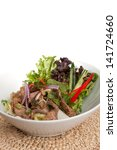 Asian style Thai salad with steak and fresh vegetables. - stock photo