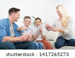 happy young family playing card ... | Shutterstock . vector #1417265273