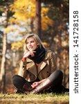 happy blond woman in autumn... | Shutterstock . vector #141728158
