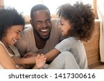 Happy African American Family...