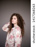 curly hair girl in jacket with... | Shutterstock . vector #1417368263