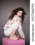 curly hair girl in jacket with... | Shutterstock . vector #1417368293
