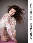 curly hair girl in jacket with... | Shutterstock . vector #1417368296