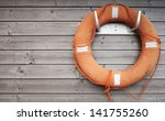 red lifebuoy with rope on...