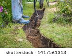 Small photo of Drainage ditch. A man is digging a ditch. Laying a drainage pipe. Earthwork.