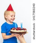 happy boy with a festive cake... | Shutterstock . vector #1417583240