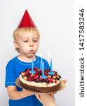 happy boy with a festive cake... | Shutterstock . vector #1417583246