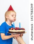 happy boy with a festive cake... | Shutterstock . vector #1417583249