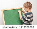 boy drawing with crayons on... | Shutterstock . vector #1417583333