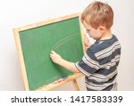 boy drawing with crayons on... | Shutterstock . vector #1417583339