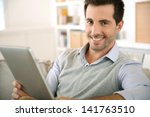smiling man websurfing on...   Shutterstock . vector #141763510