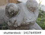 Old Statue Of Frog Weathered