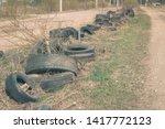 a pile of worn car tires dumped ...   Shutterstock . vector #1417772123