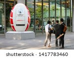 Small photo of TOKYO, JAPAN - June 5, 2019: People in front of a rugby ball-shaped object promoting 2019 Rugby World Cup by a Mitsubishi Estate Co. building in Marunouchi area. The company is a tournament sponsor