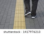 tactile paving is a system of... | Shutterstock . vector #1417976213
