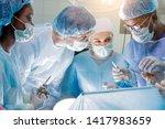 hardworking team of surgeons at ... | Shutterstock . vector #1417983659