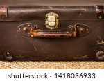 A Vintage Leather Suitcase On ...