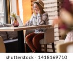 portrait of young woman using... | Shutterstock . vector #1418169710