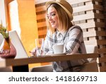 portrait of young woman using... | Shutterstock . vector #1418169713