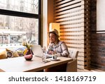 portrait of young woman using... | Shutterstock . vector #1418169719