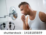 close up of a young man... | Shutterstock . vector #1418185859