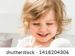 beautiful smiling blonde baby... | Shutterstock . vector #1418204306