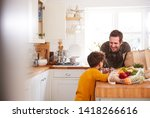 father and son coming home from ... | Shutterstock . vector #1418266616