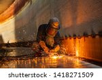 Male Worker Metal Cutting Spar...