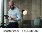 middle aged man with a tablet... | Shutterstock . vector #1418339003
