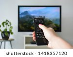 Watching Tv. A Woman\'s Hand...