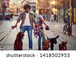 Stock photo dog walkers with group dog enjoying in city 1418502953