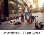 Stock photo happy couple walking dogs and enjoying outdoors 1418502986